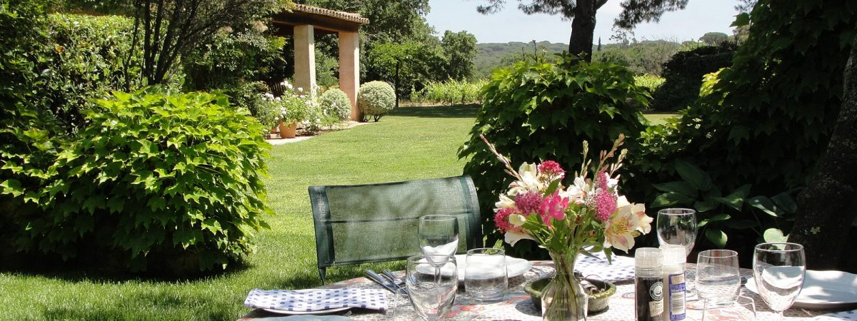 Table set for lunch in the gardens at Villa La Cotriade
